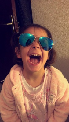 My host sister likes my glasses :)